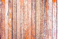 Red rustic woodden board with knots and nail holes vintage bac background Stock Photography