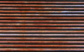 Red rusty iron pipe background texture Royalty Free Stock Photo