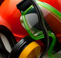 Red safety helmet with earphones Royalty Free Stock Photo