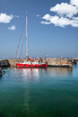 Red sailboat in the harbor Royalty Free Stock Photo