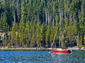 Red Sailboat on Mountain Lake Stock Photos