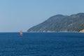 Red sailboat sailing on Aegean sea Royalty Free Stock Photo
