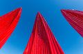 Red sails reaching towards the sky pointy petals or a clear blue Stock Photos