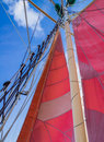 Red sails and rigging on sailing schooner ship Royalty Free Stock Image