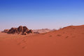 A red sand dune with a rock background in desert wadi rum Stock Images