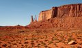 Red sand dunes and mitten at monument valley arizona Royalty Free Stock Photo