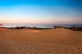 Red sand dunes in Mui Ne at sunset, Vietnam Royalty Free Stock Photo