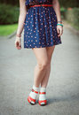 Red sandals with white socks on girl legs in fifties style Royalty Free Stock Photo