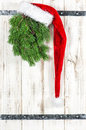 Red Santa Claus hat and green christmas tree decoration Royalty Free Stock Photo