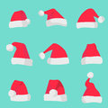 Red Santa Claus hats isolated on colorful background. Symbol of Christmas holiday. Vector santa hat set. Royalty Free Stock Photo
