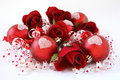 Red satin balls, with roses and ribbon. Stock Photography