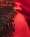 Red satin with black lace Stock Image