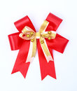 Red satin gift bow red gift bows with ribbons on white backgro background Stock Photos