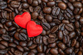 Red satin hearts on coffee beans, valentines or mothers day background, love celebrating Royalty Free Stock Photo