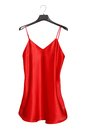 Red satin nightdress on hanger Stock Images