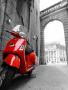 Red scooter with black & white surroundings Royalty Free Stock Photo