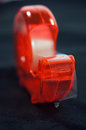 Red scotch tape close up shot of a dispenser Royalty Free Stock Photography