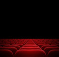 Red seats in dark cinema theater Royalty Free Stock Photo