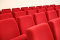 Red seats rows of velvet in a big hall Royalty Free Stock Image