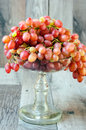 Red seedless grapes in a vase Stock Photos