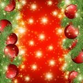 Red shiny background with Christmas decorations, decorative spruce branches, golden stars , holiday Merry X-mas and Happy New Year