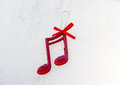Red shiny decorative christmas music notes