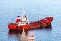 Red ship neat malta coast Royalty Free Stock Photos