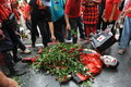 Red shirt rally in bangkok protesters lay roses on the body of an activist depicting the scene where japanese journalist hiro Royalty Free Stock Images