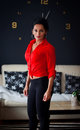 Red shirt and tight pants woman in Stock Images
