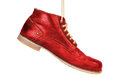 Red shoes leather hanging on a cord subject isolated Royalty Free Stock Photography