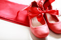 Red shoes with ribbon gift wrapped girls Royalty Free Stock Photos