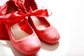 Red shoes with ribbon gift wrapped girls Royalty Free Stock Image