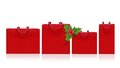 Red shopping bag and holly berry sprig on a white background Royalty Free Stock Image