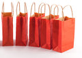 Red shopping bag line group of bags in a row on a white background Stock Photography