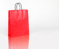 Red shopping bag with space for your logo or text on white spece Stock Images