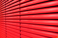 Red shutter vertical lines of a blind Stock Photography