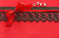 Red silk background with lace and ribbons decorated Stock Image