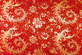 Red silk with floral pattern Royalty Free Stock Photo