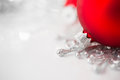 Red and silver xmas ornaments on bright holiday background. Royalty Free Stock Photo