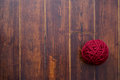 Red skein over wooden background Royalty Free Stock Photo