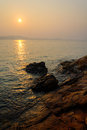 Red sky over a rocky seashore Sunset Royalty Free Stock Photo