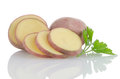 Red sliced potatoes on white reflective background Stock Photos