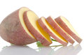 Red sliced potatoes on white reflective background Royalty Free Stock Images