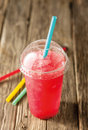 Red Slushie Drink in Plastic Cup with Straws Royalty Free Stock Photo