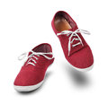 Red sneakers dancing isolated shoes on white background Royalty Free Stock Photography