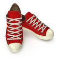 Red sneakers isolated on white. 3D illustration
