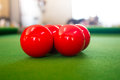 Red snooker balls on green pool table Royalty Free Stock Images