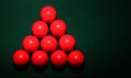 Red snooker balls on table a set of in a triangle green pool Royalty Free Stock Image