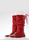 Red snow boots on a white Royalty Free Stock Photo