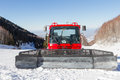 Red snowcat in mountains of Kazakhstan Royalty Free Stock Photo